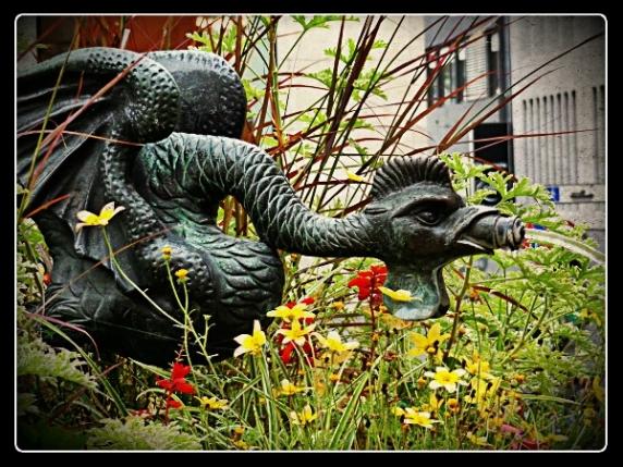 basilisk fountain w flowers