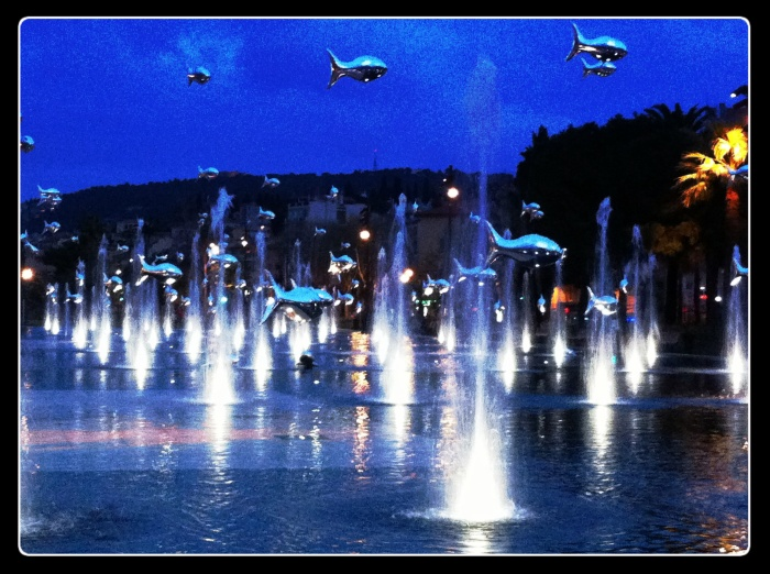 In Nice, France, the April Fish swim above the water.  For the city's April Fool's day joke, they attached silver balloon fish above the fountain.  It was amazingly beautiful and I almost missed it.  I didn't discover it until evening.  In France the April Fool's day jokes are known as April Fish.